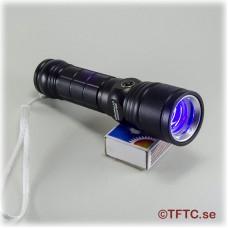 Combination UV/regular flashligt